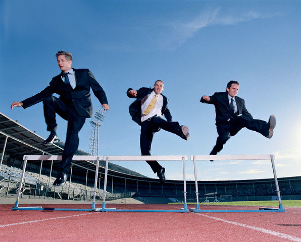Businessmen Jumping Over Hurdles